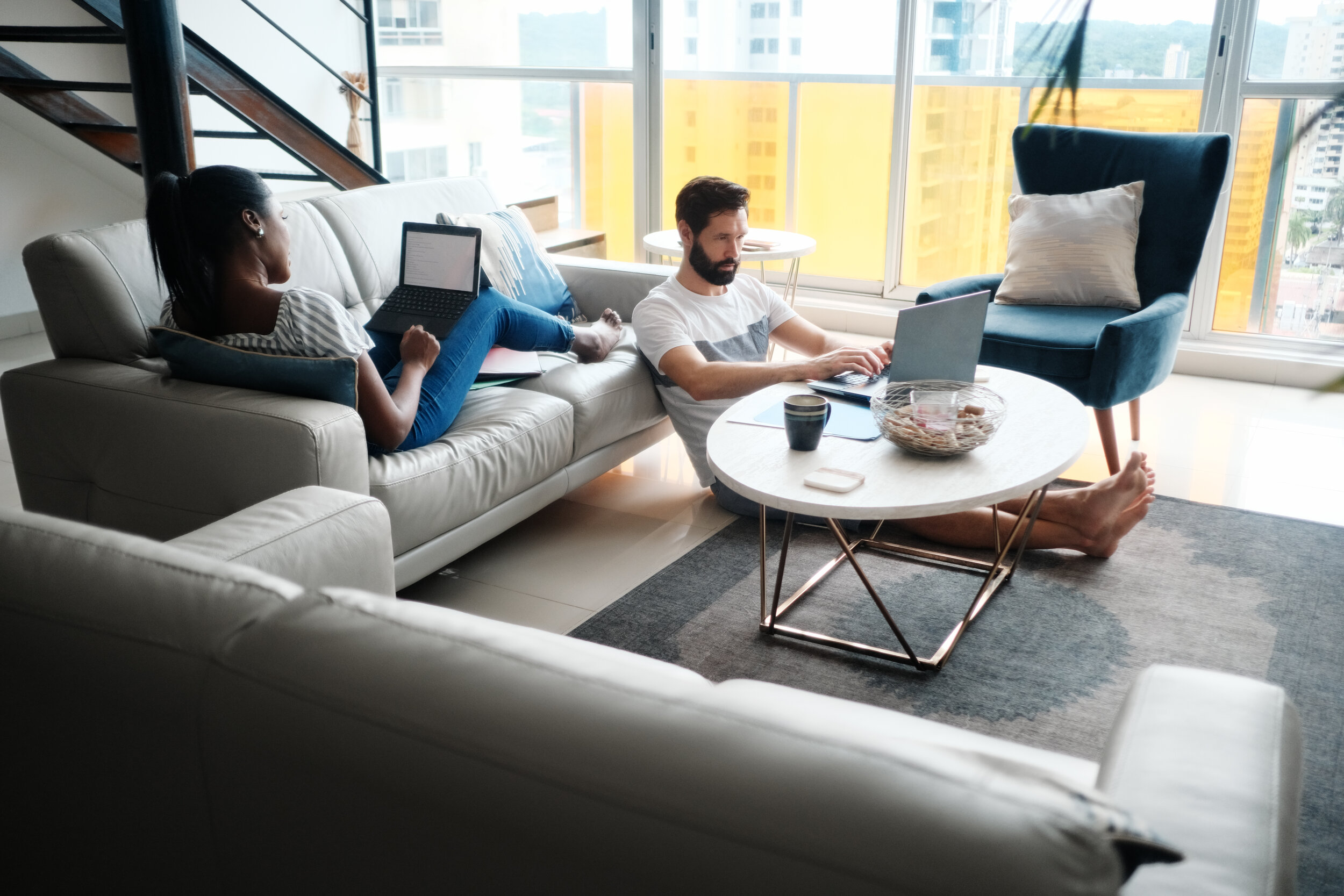 couple-working-from-home-with-laptop-computer